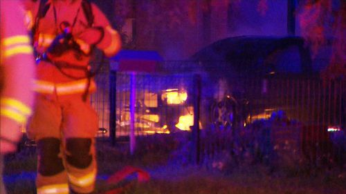 The fire swamped a car out front of the house. (9NEWS)