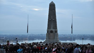 Crowds gather at the Kings Park State War Memorial in Perth. (AAP)
