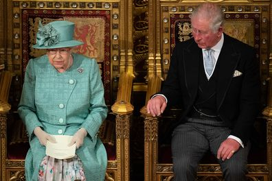 Queen Elizabeth II and the Prince of Wales sit in the chamber, during the State Opening of Parliament in 2019.