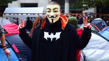 Protester wearing a V for Vendetta mask in London in 2011. Anonymous became synonymous with the Guy Fawkes mask.