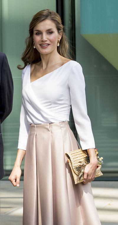 Queen Letizia in a Topshop skirt at the Francis Crick Institute during a State visit by the King and Queen of Spain in London in July, 2017