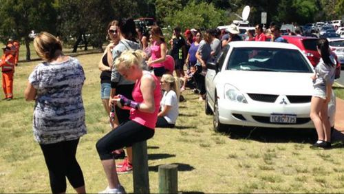 Searchers sit despondent after being told the body of Sam Trott has been found. (9NEWS)