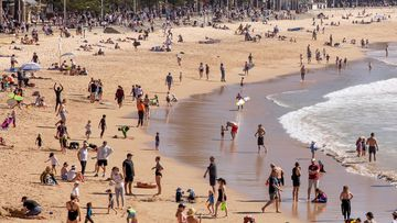 Sydneysiders enjoy the warming weather at Manly Beach.