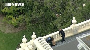 9RAW: Police arrest shirtless man on the rooftop of Government House