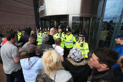 "Police block protesters from the entrance to Alder Hey Children's Hospital in Liverpool, England, Monday April 23, 2018 after the European Court of Human Rights rejected an appeal against the decision to end life-support for Alfie Evans, a terminally-ill toddler. Alfie is in a ""semi-vegetative state"" as the result of a degenerative neurological condition that doctors have been unable to definitively identify. (Peter Byrne/PA via AP)"