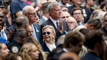 Hillary Clinton (centre), stands in front of New York mayor Bill de Blasio during the September 11 memorial. (AP)