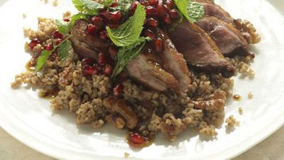 Cracked wheat and walnut pilaf with duck and pomegranates