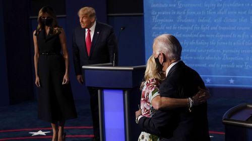 Democratic presidential candidate former Vice President Joe Biden hugs his wife Jill Biden as President Donald Trump stands by First Lady Melania Trump.
