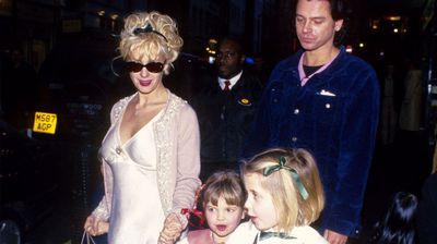 Peaches' mother, Paula Yates, with INXS frontman Michael Hutchence, and her two children with Bob Geldof, Fifi Trixibelle (left) and Peaches (right) in 1996.