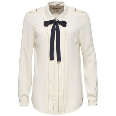 "<p><a href=""https://global.tommy.com/au/en/collections/holiday/20"" target=""_blank"">Tommy Hilfiger Rosetta Blouse, $299.</a></p> <p>Co-worker wearing all-white too? Swap to a blouse with details such as this demure yet also right on trend style.</p>"