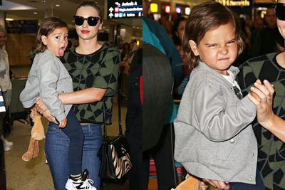 <br/>Sexy supermodel Miranda Kerr has arrived in Sydney with son Flynn in tow... who doesn't look too impressed by all the flashing bulbs at the airport. <br/><br/>What's a kid to do but pull funny faces at the paps? Check out the cheeky shots here... <br/><br/>Source: Splash
