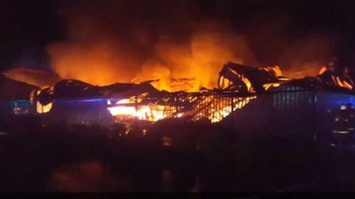 Firefighters battle large factory fire in Sydney's west