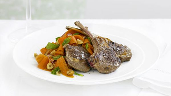 Lamb cutlets with spiced carrot and hazelnut salad