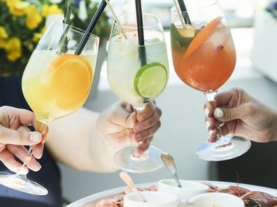 Cheering with cocktails, summer party outdoors