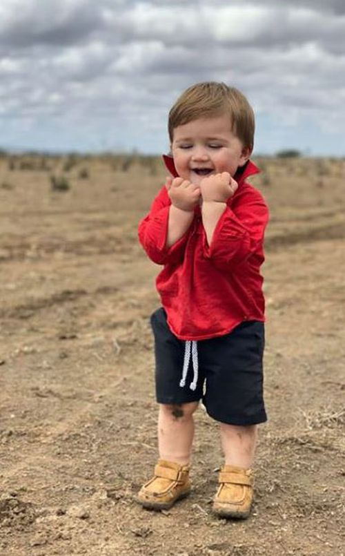 Dominique Facer posted the photo of her son's first ever taste of rain to farming Facebook page One Day Closer to Rain.