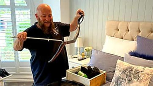 Barry Goldsmith, from The Snake Catcher Victoria, was called to the man's home to collect and relocate the red-bellied black snake yesterday.