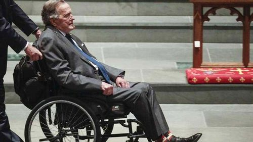 George HW Bush, who has died, in April at his wife Barbara's funeral.