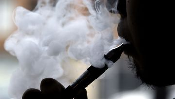 In this 2013 file photo a man can be seen smoking an electronic cigarette.