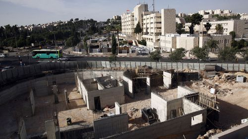 This 2016 photo shows construction on land owned by Palestinian Mohammad Abu Taâ discovered some years ago that the Israeli government had expropriated the piece of land in Jerusalem belonging to his family.(Photo: AAP)