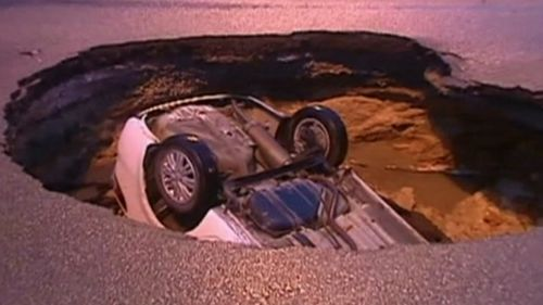 The driver and his passenger escaped safely. (9NEWS)