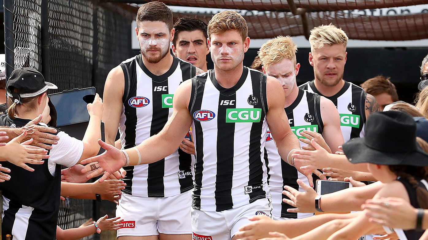 Taylor Adams of the Magpies runs out during the 2020 AFL Marsh Community Series