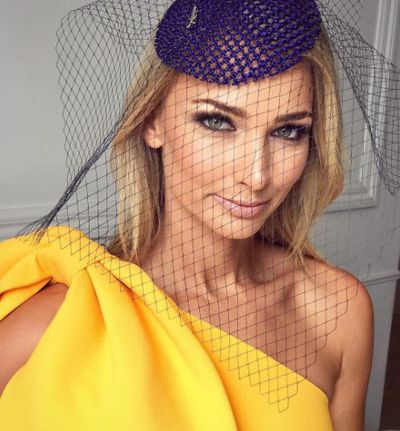 "Former Bachelorette Anna Heinrich injected a little sunlight into her look ""CUP DAY READY..... feeling like sunshine ☀️ "" captioned Heinrich, wearing Rebecca Vallance"