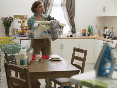 Woman doing housework collecting laundry