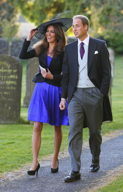 In October 2010, just before Prince William and Kate became engaged, the two stepped out for the wedding of Harry Meade to Rosie Bradford.<br /> Kate paired a neon blue silk Issa dress with a cropped black jacket and matching headpiece.