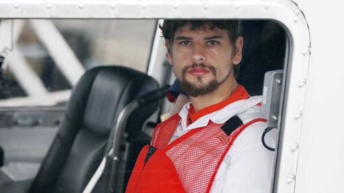 Nathan Carman upon his rescue from a week adrift at sea. (AAP)