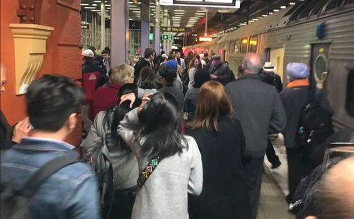 Sydney train commuters are experiences delays of up to an hour after 'urgent wiring repairs' at Wynyard station has led to a communications failure.