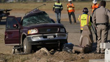 A law enforcement officer examines the scene of the deadly crash in Holtville, California.