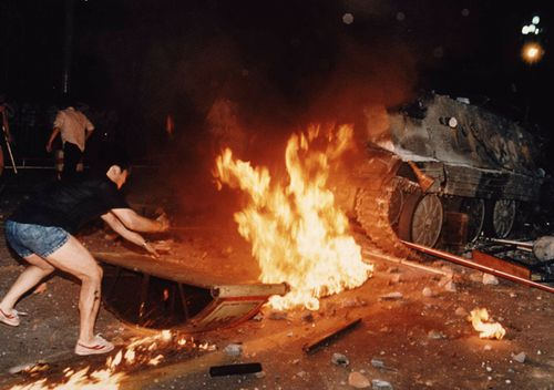 A student protester puts barricades in the path of an already burning armored personnel carrier that rammed through student lines during an army attack on anti-government demonstrators in Beijing's Tiananmen Square.