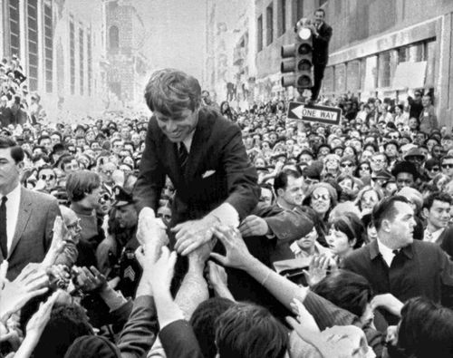 In this April 2, 1968 file photo U.S. Sen. Robert F. Kennedy, D-NY, shakes hands with people in a crowd while campaigning for the Democratic party's presidential nomination on a street corner, in Philadelphia