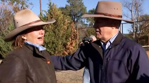 Prime Minister Malcolm Turnbull embraced a woman struggling with the devastating drought during his tour of the region yesterday. Picture: 9NEWS