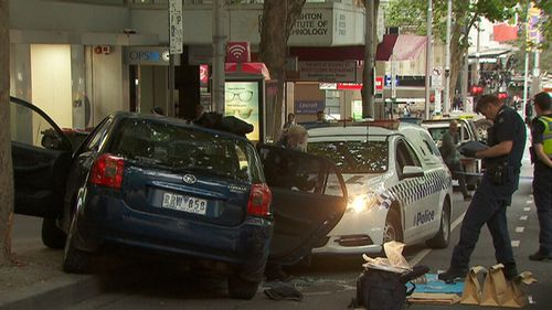 Ireland's stolen Corolla mounted the pavement after hitting the police car. (9NEWS)