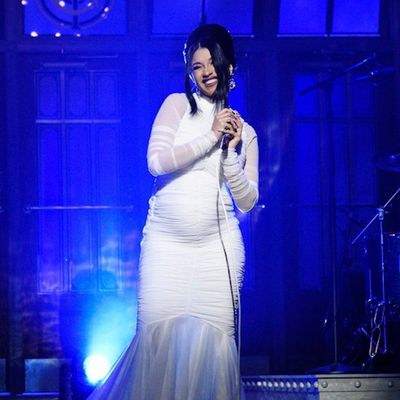 Cardi B revealing her pregnancy for the first time on Saturday Night Live wearing custom Christian Siriano on April 8, 2018