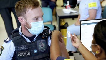 New South Wales Police officer Lachlan Pritchard receives the Pfizer vaccine at the Royal Prince Alfred Hospital Vaccination Hub in Sydney.