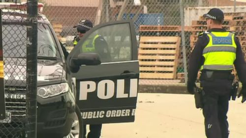 Fourteen men were arrested in the early-morning raids. (9NEWS)