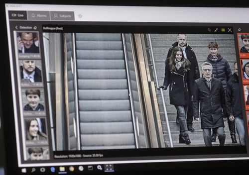 A computer with an automatic facial recognition system shows German commuters in the Suedkreuz train station in Berlin.
