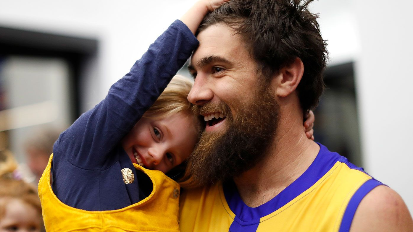Josh Kennedy of the Eagles celebrates with daughter Lottie
