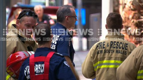 Firefighters outside the building, which also houses the office of the NSW Premier Gladys Berejiklian.