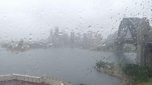 Sydney Harbour was hit by rain.