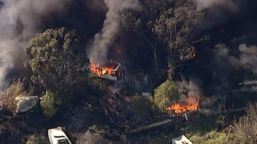 Fire carves a trail of destruction near Penrith, in Sydney's West. (9NEWS)