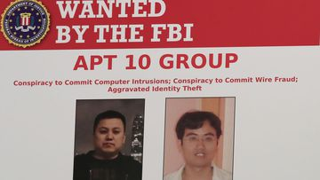A poster displayed during a news conference at the Department of Justice in Washington
