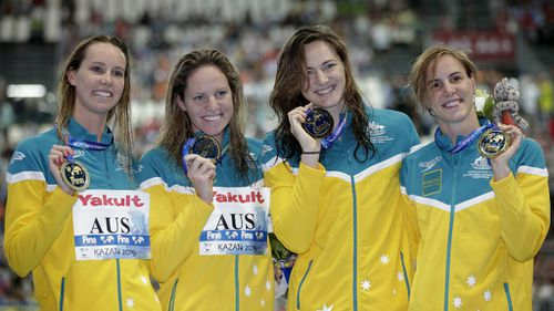 The Australian women's 4x100m freestyle relay team from left, Emma McKeon, Emily Seebohm Cate Campbell and Bronte Campbell celebrate with their gold medals at the Swimming World Championships in Kazan, Russia. (AAP)