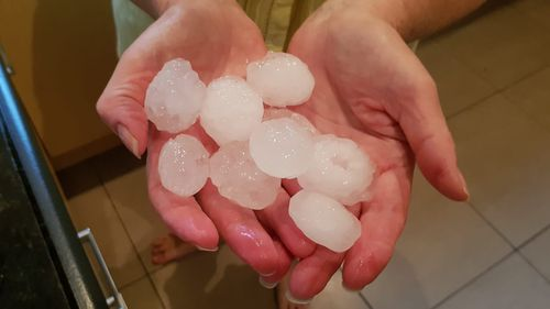 Residents in Campbelltown in Sydney's south-west collect giant hailstones. (Supplied)