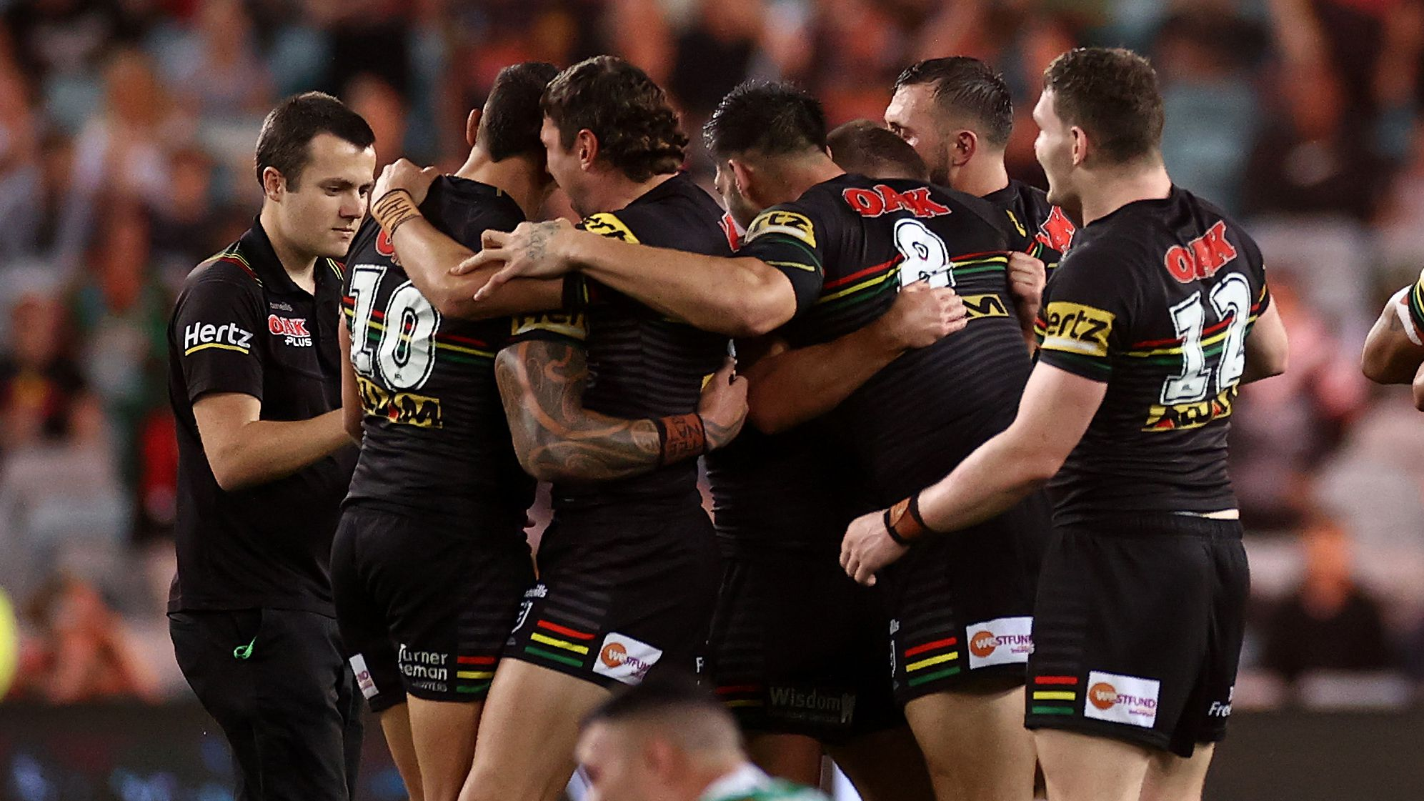 The Panthers celebrate their victory over the Rabbitohs.