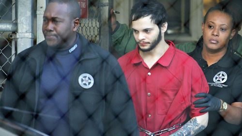Esteban Santiago, centre, admitted shooting dead five people at Fort Lauderdale Airport after he took a gun onto a plane. (Photo: AP).