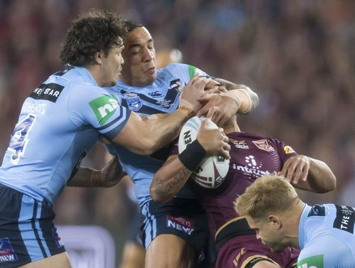 Valentine Holmes is hauled to the ground face first. Picture: AAP