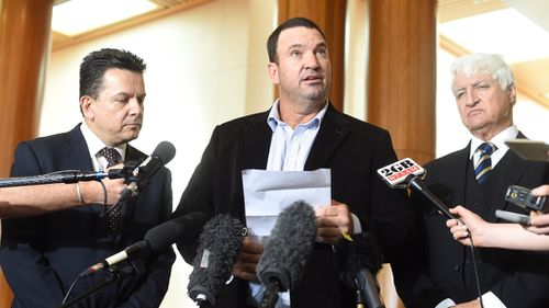 Senator Nick Xenophon, cattle farmer and BBHO syndicate member Sterling Buntine and MP Bob Katter spoke at Parliament House on Thursday. (AAP)